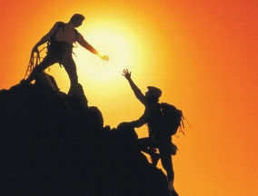 mountain-climbers-reaching-summit